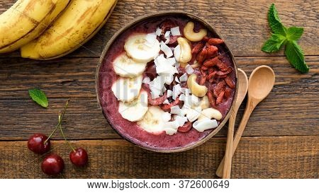 Acai Smoothie Bowl With Superfood Toppings. Healthy Vegan Acai Blueberry Smoothie Bowl With Banana,