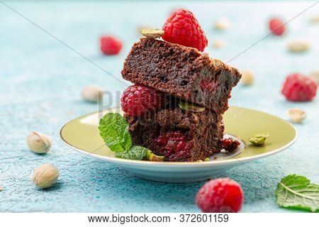 Homemade Dark Chocolate Brownies With Sea Salt And Raspberries Served On A Plate With Fresh Raspberr