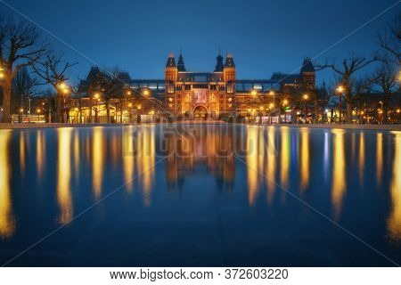 Amsterdam City Museum, Netherlands. Beautiful Iconic View Illuminated At Night