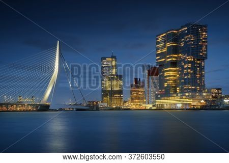 Rotterdam City Skyline Cityscape, Netherland (holland) At Night. View Of Downtown And Erasmus Bridge
