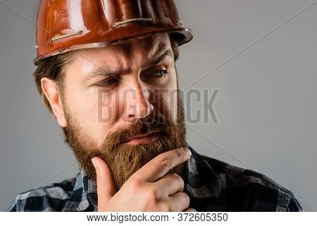 Builder Concept. Building, Industry, Technology. Builder In Hard Hat. Portrait Of Bearded Workman. A