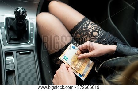 Female Prostitute In Car With Money In Her Hands.