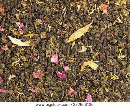 Tie Guan Yin Tea With The Petals Of Lilac, Hibiscus And Sunflower. Organic Tea Background. Top View.