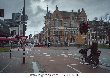 Haarlem, Netherlands - March 6, 2020: People Are Walking On The Street In Haarlem City Center Old To