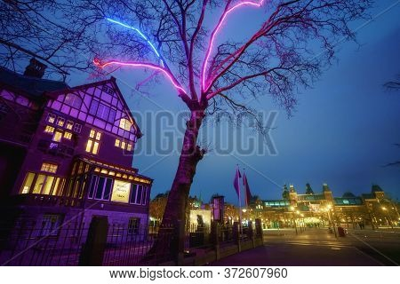 Amsterdam, Netherlands - March 7, 2020: Empty Streets Near Moco Museum Illuminated At Night In Amste