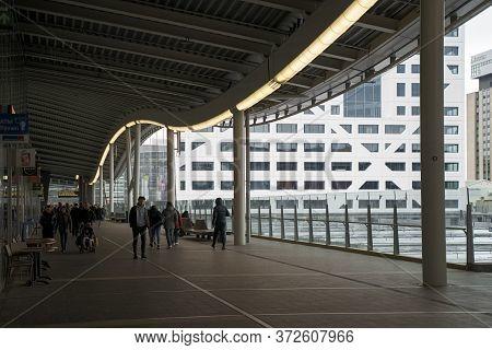 Utrecht, Netherlands - March 8, 2020: People Are Walking On The Street In Utrecht City Near Railway