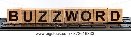 Buzzword Word Made With Building Blocks. A Row Of Wooden Cubes With A Word Written In Black Font Is