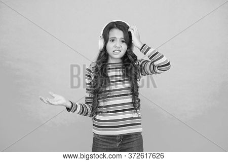 Girl Listen Music In Headset. Audio Book For Kids. Amazed Teen Child. Schoolgirl Wear Colorful Cloth