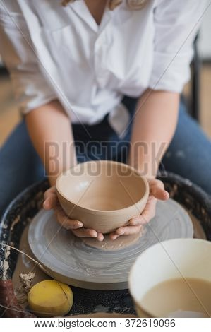 The Female Potter Finished Making A Clay Vase Remove It From The Potters Wheel. Creating Vase Of Whi
