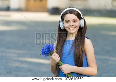 Summer Music Festival. Happy Child Listen To Music Outdoors. Little Girl Wear Headphones Playing Mus