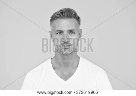 Handsome And Charismatic. Handsome Guy Yellow Background. Unshaven Man With Handsome Face. Skincare