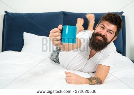 Enjoy Your Cup Of Coffee Every Day. Happy Hipster Enjoy Coffee In Bed. Bearded Man Give Hot Cup. Cof