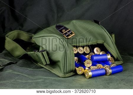 Shotgun Cartridges And Cartridge Bag On A Waxed Outdoor Coat