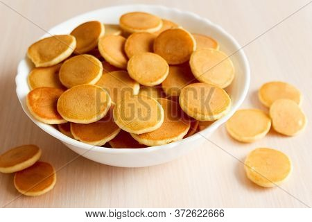 Mini Pancake Cereal For Breakfast. Mini Pancake Cereal Is New Trend. Mini Pancakes Cereal Served For