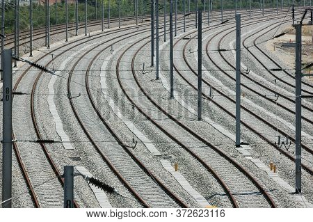 Numerous Rail Lines In A Bend Creating Patterns Converging Into The Distance
