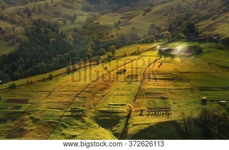 Early Summer Morning In A Small Carpathian Village. The First Rays Of The Sun Lit Slopes Carpathian