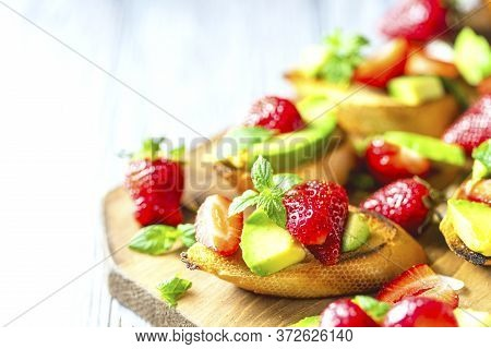 Summer Snack. Delicious Homemade Crostini With Strawberries And Avocado. Proper Nutrition, Balanced