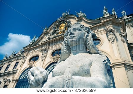 Vienna, Austria - August 27, 2019. Woman Statue On The Background Of The Belvedere Palace In Vienna