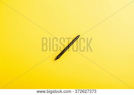 Top View Of Black Stylus Isolated On Yellow