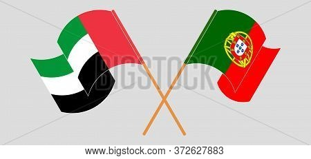 Crossed And Waving Flags Of Portugal And The United Arab Emirates. Vector Illustration