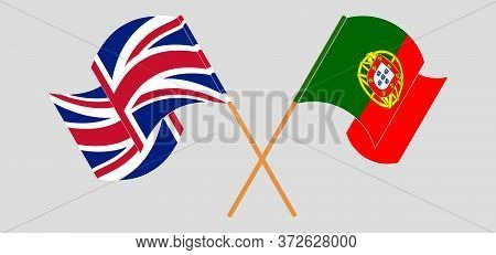 Crossed And Waving Flags Of Portugal And The Uk. Vector Illustration