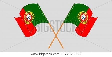 Crossed And Waving Flags Of Portugal. Vector Illustration