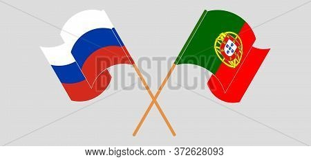 Crossed And Waving Flags Of Portugal And Russia. Vector Illustration