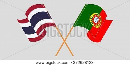 Crossed And Waving Flags Of Portugal And Thailand. Vector Illustration