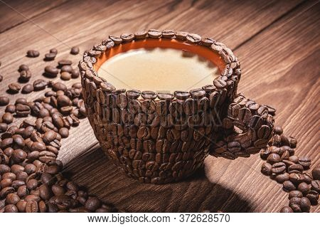 Close-up Cups. Coffee Cup With Coffee Made From Coffee Beans Wooden Table. Natural Coffee Beans Arab