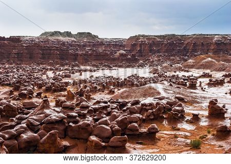 Many funny  figures of red-brown sandstone. Scenic Utah state park Goblin Valley. USA. Hoodoo - high thin geological formations. The concept of active, informative, ecological and photo tourism
