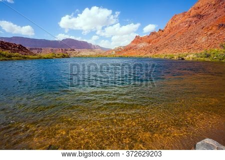 Lee's Ferry is a historic boat ferry across the Colorado River. Wide river with rapids and steep banks of red sandstone. Amazing wildlife. USA. The concept of active, extreme and photo tourism