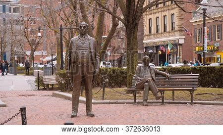 Bronze Statues Of A Sitting And Standing Man In Boston - Boston. Usa - April 5, 2017