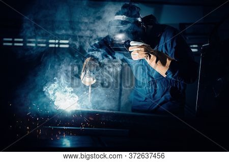 Technical Welder Is Working Steel Welding In Assembly Workshop, Welder Structure In Safety Equipment
