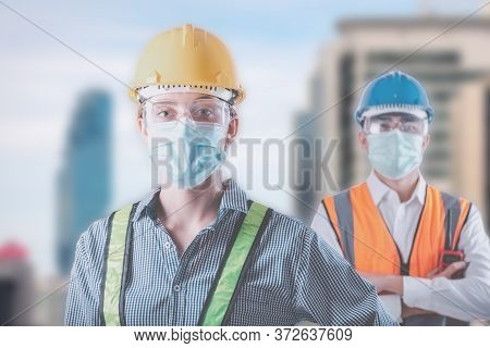 Coronavirus Covid-19 Disease Epidemic Crisis Situation, Construction Worker Standing In Line For Fev