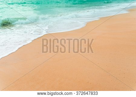 Top View Of Sand And Water Clean Beach And White Sand In Summer With Sun Light Blue Sky And Bokeh Ab