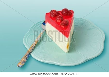 Portion Piece Of Cheesecake With Fresh Strawberries And Strawberry Jelly On A Vintage Teal Plate On