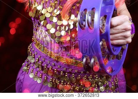 Belly Dancer Wearing Purple Close-up With Red Bokeh