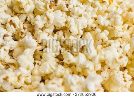 Background Of Popcorn Grains. The Texture Of The Popcorn.close Up.