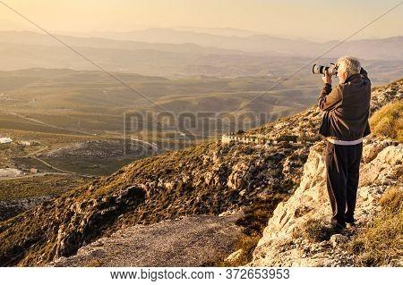 Male Tourist With Camera Taking Travel Photo From Coastal Spanish Landscape, Mesa Roldan Location In