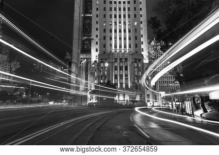 Light Trails Of Car Traffic In Downtown District Of Hong Kong City At Night