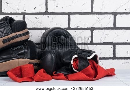 Equipment And Equipment For Boxing And Martial Arts On A White Brick Wall