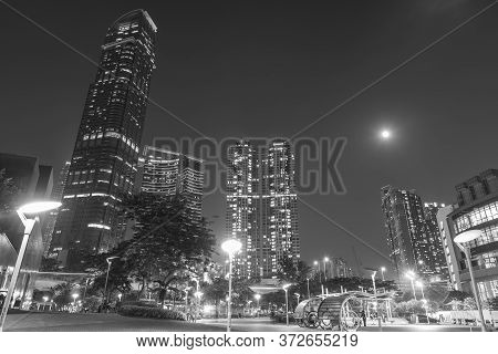Modern Skyscraper And High Rise Residential Building In Hong Kong City At Night