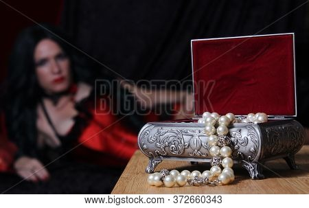 Vintage Jewelry Box With Woman Wearing Red Corset In Background