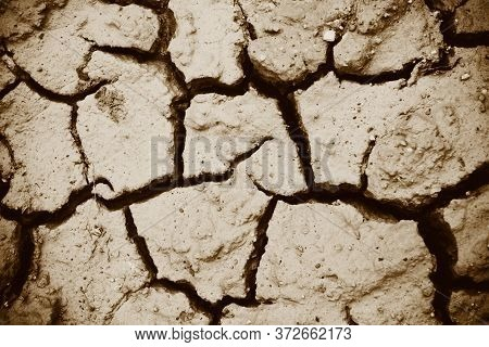 Cracks Of The Dried Soil In Arid Season / Arid Soil , Cracked Earth Texture Of Ground Broken And Rou