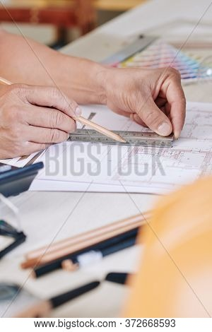 Hands Of Architect Using Pencil And Ruler When Drawing Blueprint Of House