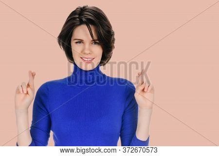Portrait Of Young Hopeful Woman Praying On Sepia Color Background