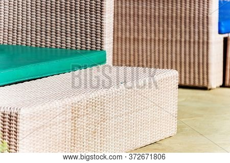 Wall And Bench. Fragments Of Rattan Furniture. Selective Focus, Blurr. Soft Focus