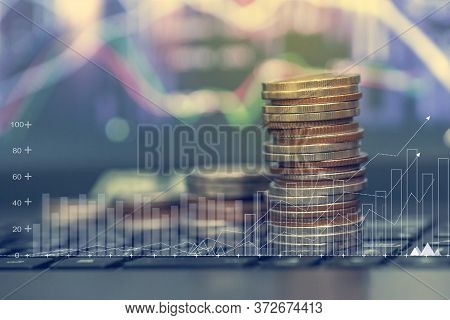 Concept Finance/ Saving Money For Future Growth.financial Stock Market Graph And Rows Of Coins Growt
