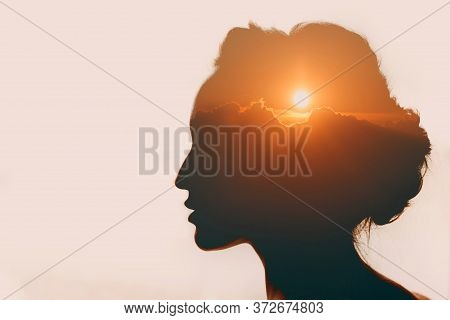 Woman With Sun Over Clouds In Her Head. Mental Health Concept