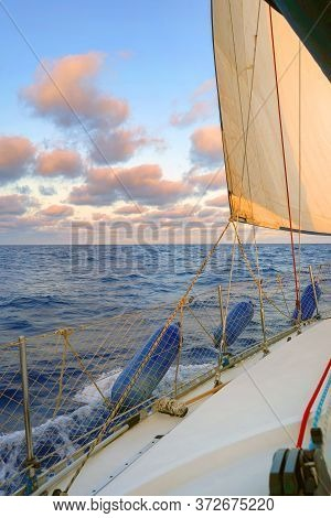 Sailing Boat Wide Angle View In The Sea. Yacht In The Sea Under Sail At High Speed In A Strong Wind